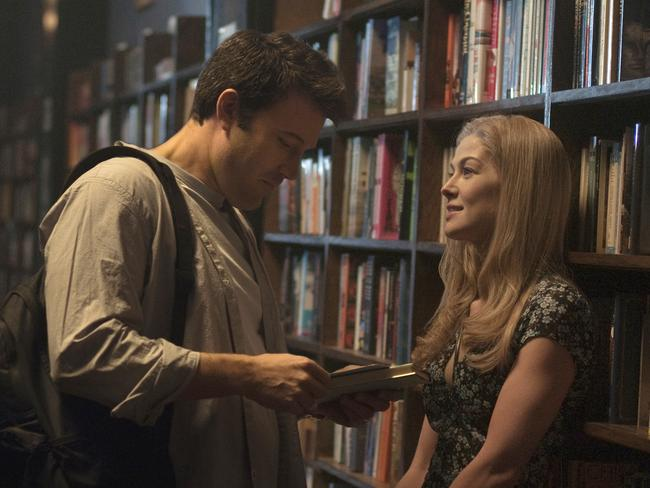 Ben Affleck, left, and Rosamund Pike appear in a scene from Gone Girl.
