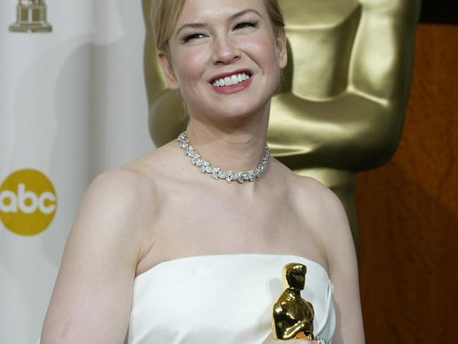 Renée Zellweger poses with her Oscar she won for Best Supporting Actress.
