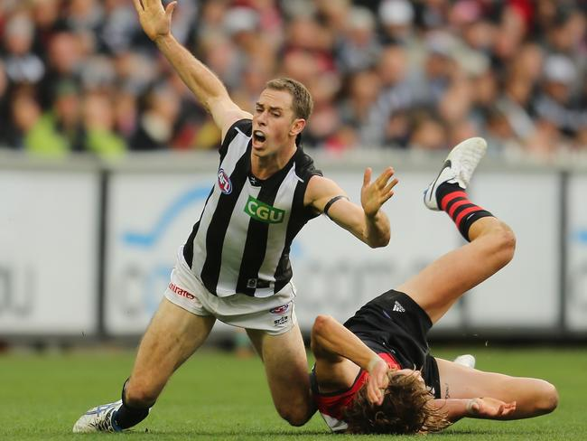 Nick Maxwell injured his ankle in this clash with Joe Daniher. Photo by Scott Barbour