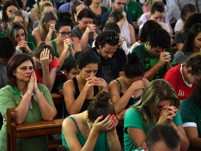 People attend a mass in memoriam of the players of Brazilian team Chapecoense Real.