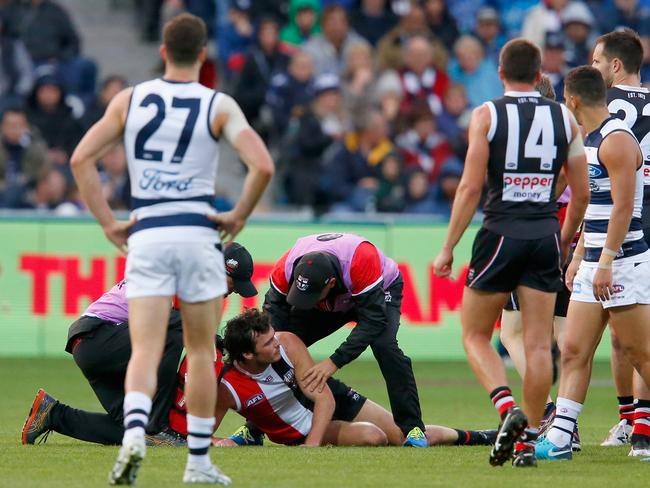 Saints medical staff attend to Dylan Roberton as players look on. (Photo by Darrian Traynor/Getty Images)