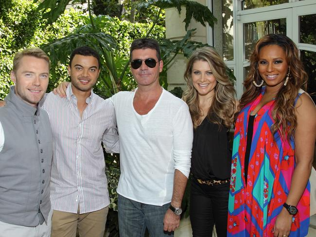 X Factor creator Simon Cowell (C) flanked by judges Ronan Keating (L), Guy Sebastian, Natalie Bassingthwaighte and Mel B.