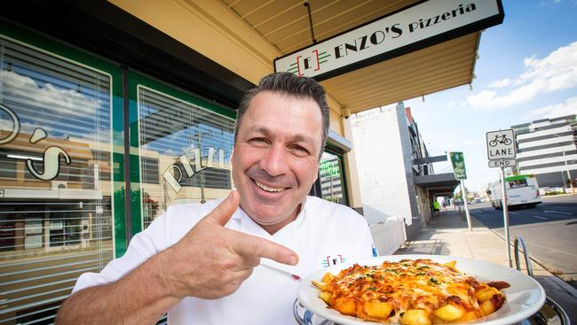 Enzo Cucinotta with his creation the Italian snack pack out the front of his Melbourne pizza shop. Picture: Mark Stewart
