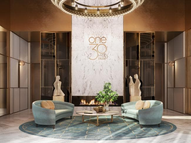 The glam foyer of ONE30 Hyde Park is dripping in sandstone and marble finishes and has a concierge.