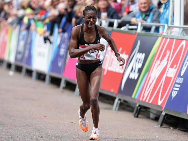 Beata Naigambo starts to struggle near the marathon finish. Picture: Adam Head