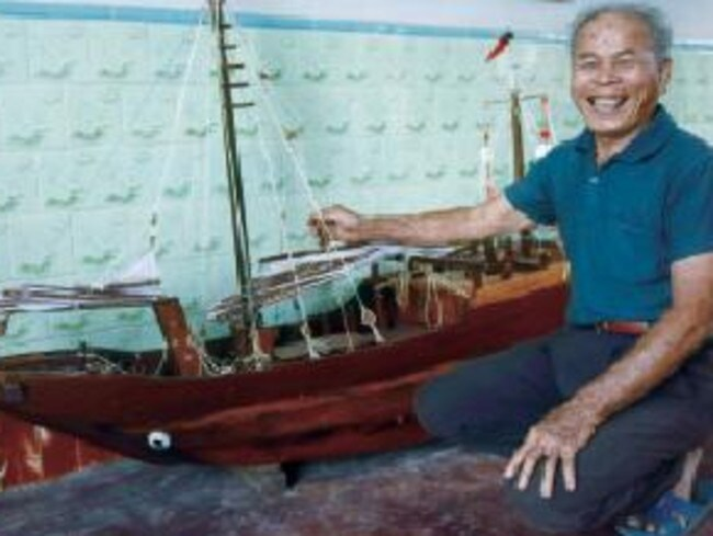 Fisherman Su Chengfen, pictured with a model boat he constructed from wood, told the BBC he had 'thrown the book away'.