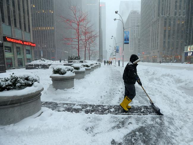 Heavy work ... Winter storm Jonas brings heavy snow and blizzard conditions to New York City. Mid-town Manhattan. Picture: Nathan Edwards