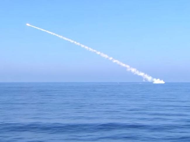 A screen capture of Russian Ministry of Defence footage claiming to show the submarine Krasnodar launching a cruise missile, while submerged, at targets in Syria earlier this year.