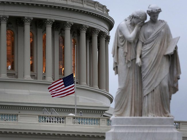 A U.S. flag flies at half staff on the US Capitol on Capitol Hill in Washington, DC. Picture: Alex Wong/Getty Images/AFP