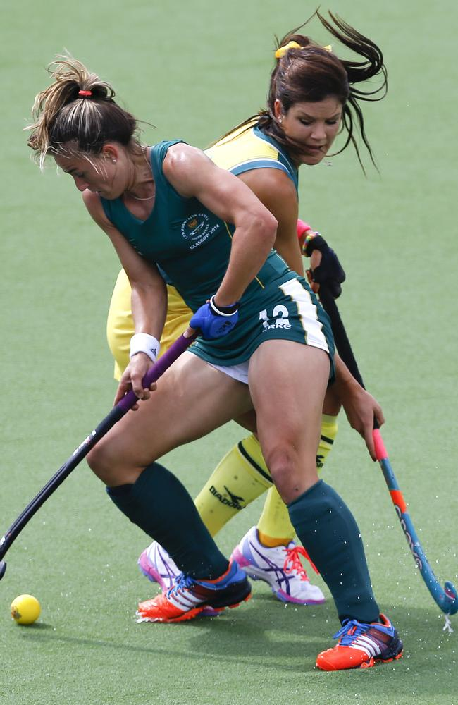 Australia's Anna Flanagan, right, vies for the ball with South Africa's Dirkie Chamberlain during their semi final hockey match.