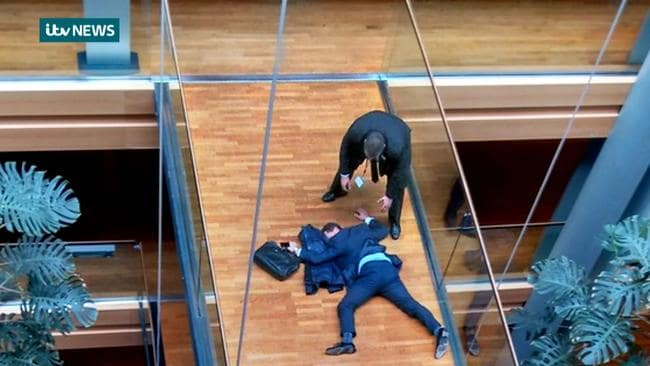 A few weeks ago UKIP's Mr Woolfe was seen lying facedown on a walkway inside the European Parliament building in Strasbourg. Picture: ITV NEWS/AFP