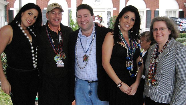 Natalie Khawam, left, David Petraeus, Scott and Jill Kelley, and Holly Petraeus watch at a party on the Kelley's front lawn in Tampa, Florida.