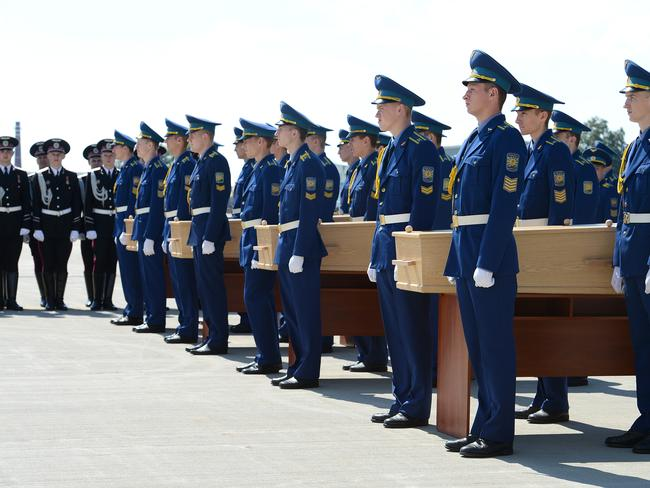 Four bodies are carried during a ramp ceremony at Kharkiv Aiport, Kharkiv, Ukraine / Picture: AAP