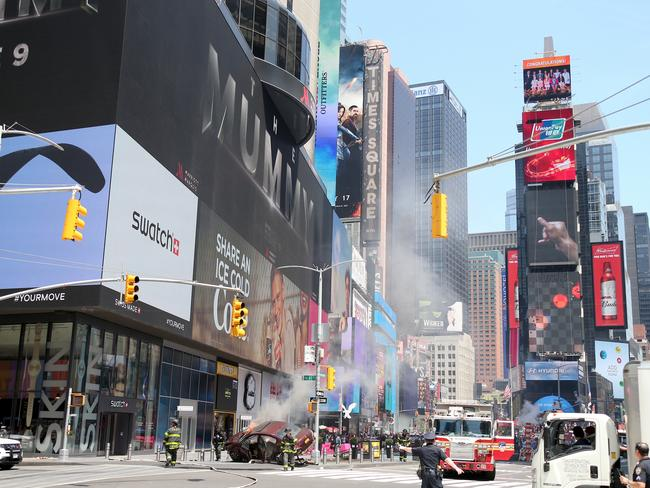 The crashed car in New York's Times Square. Picture: Diimex.