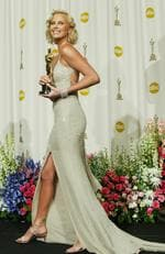 Charlize Theron wore a glittering silver 20s-themed Gucci Gown when she claimed Best Actress and arguably best dressed at the 2004 Academy Awards. Picture: Getty