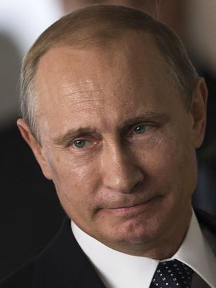 Saying one thing, doing another ... Russian President Vladimir Putin. Picture: Felipe Dana