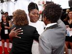 Danielle Brooks hugs actos Gaten Matarazzo and Caleb McLaughlin at The 23rd Annual Screen Actors Guild Awards on January 29, 2017 in Los Angeles, California. Picture: Getty