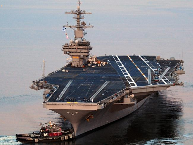 Floating fortress ... The Nimitz-class aircraft carrier USS George H.W. Bush is being sent into the Persian Gulf in response to the startling success of insurgents in Iraq. President Obama, however, says military force will only be applied if Iraq proves willing to defend itself.