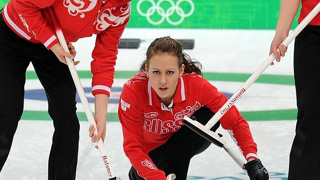 Ekaterina Galkina throws a stone during a curling match against Japan at the 2010 Winter Olympics.