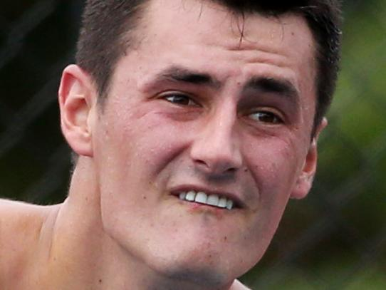 Federer has last laugh on Tomic