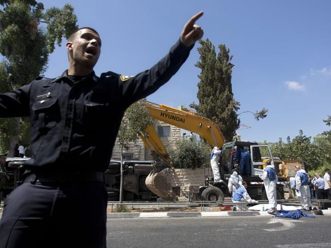 Investigators ... Israeli police stand guard at the scene of the attack in Jerusalem. Picture: AP