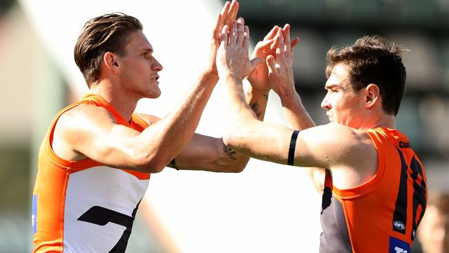 Rory Lobb and Jeremy Cameron celebrate a Giants goal.