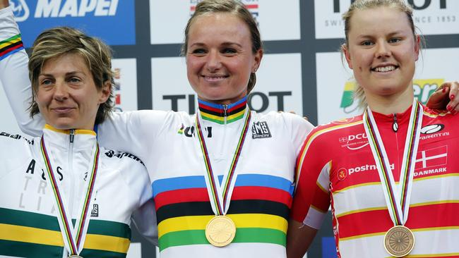 World Champion and gold medalist Chantal Blaak, centre, of The Netherlands flanked by silver medalist Katrin Garfoot, left of Australia and bronze medalist Amalie Dideriksen of Denmark pose for a photograph on the podium after the UCI Cycling Road World Championships World Championships Women Elite Road Race in Bergen, Norway, Saturday, Sept. 23, 2017. (Cornelius Poppe/NTB Scanpix via AP)