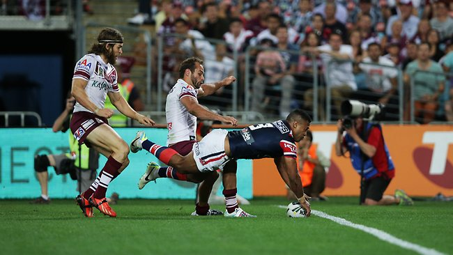 Michael Jennings scores a freak try for the Roosters. Picture: Gregg Porteous