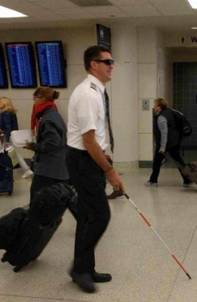 This pilot was spotted walking through a busy airport with a walking aid. Picture: Whitlow14