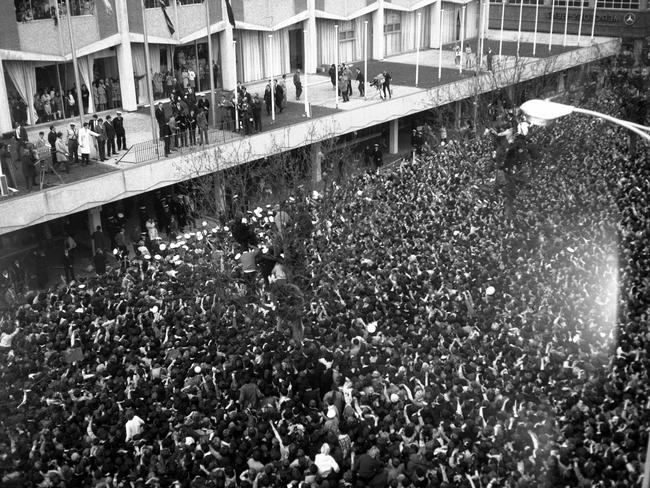 June 14, 1964: Fans flock to the Southern Cross Hotel where the band appeared on the balcony. Picture: Herald Sun Image Library