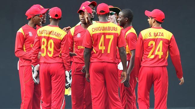 Zimbabwe's Donald Tiripano (2R) celebrates with teammates after taking ...