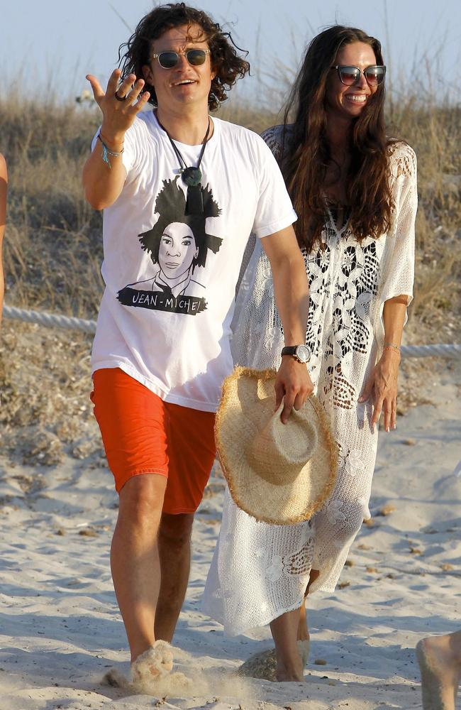 Orlando Bloom and Erica Packer walk along the beach in celebrity playground Formentera, the sister island of Ibiza. Picture: Splash Group