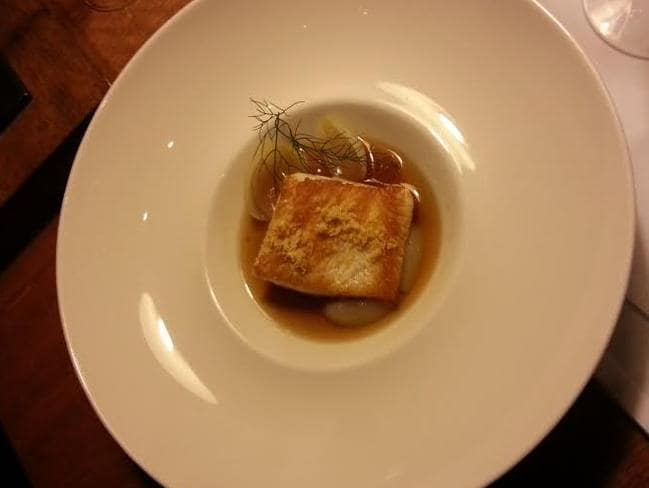 Yellowtail kingfish in ham hock consommé with Jerusalem artichoke puree, onion petals and pork scratchings. Seriously yum.