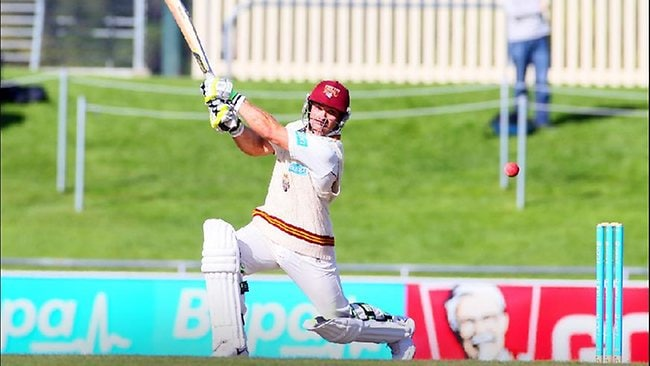 Chris Hartley hits out for Queensland in the Sheffield Shield final against Tasmania. Picture: Luke Bowden
