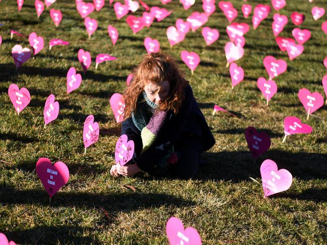 A marriage equality advocate sets up paper hearts during the 'Sea of Hearts' event supporting Marriage Equality outside Parliament House in Canberra on Tuesday, August 8, 2017. Picture: Lukas Coch/AAP