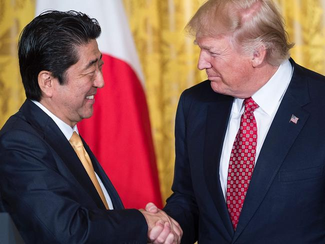 Japan's Prime Minister Shinzo Abe (L) and US President Donald Trump shaking hands. Picture: AFP