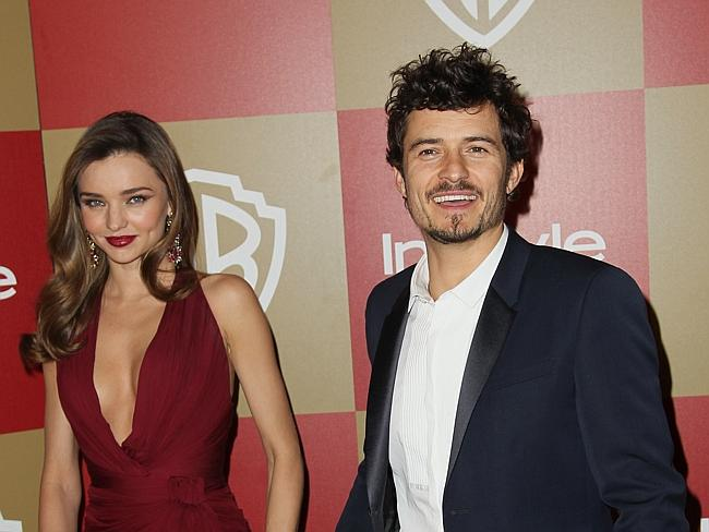 Miranda Kerr, left, and Orlando Bloom arrive at the InStyle and Warner Bros. Golden Globe After Party at the Beverly Hilton Hot