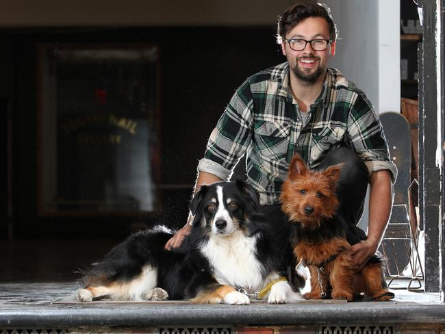 Jake Holmes from the Tooth & Nail gallery with his two dogs Walter and Ira. Picture: Stephen Laffer