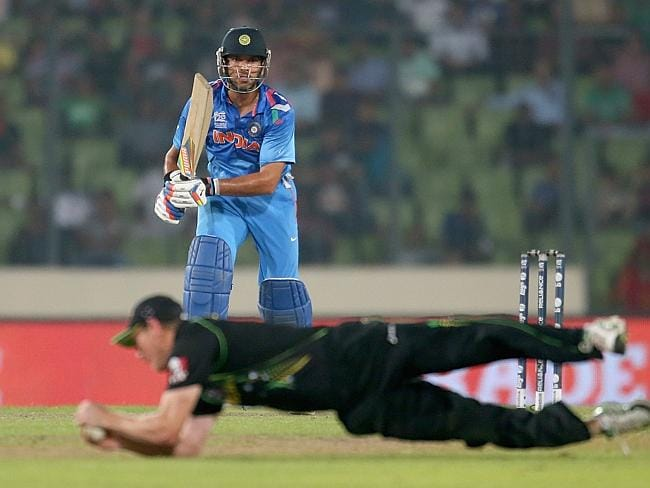 George Bailey dives to stop a shot by India's Yuvraj Singh. Picture: Scott Barbour/Getty Images