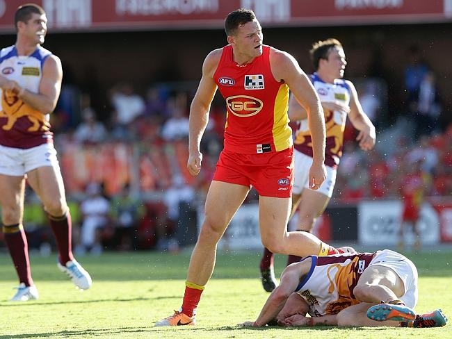Steven May cleans up Dayne Zorko during the round 3 AFL game between the Gold Coast Suns and the Brisbane Lions from Metricon Stadium. Picture: Adam Head