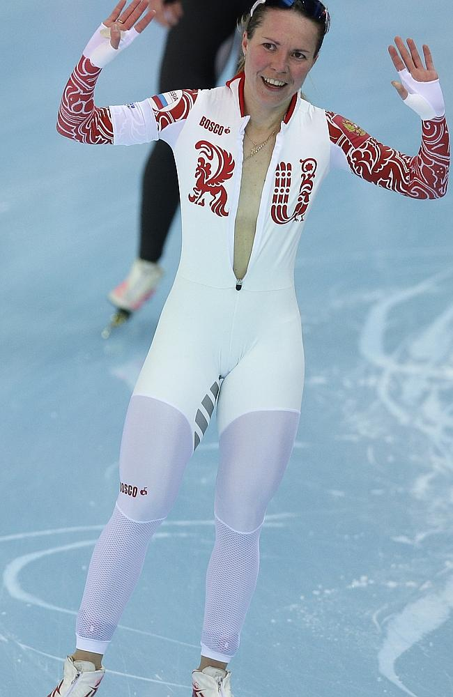 Bronze medallist Olga Graf of Russia celebrates with a wide open front of her skin suit after the women's 3000-metre speed skating race in Sochi last week. Picture: AP