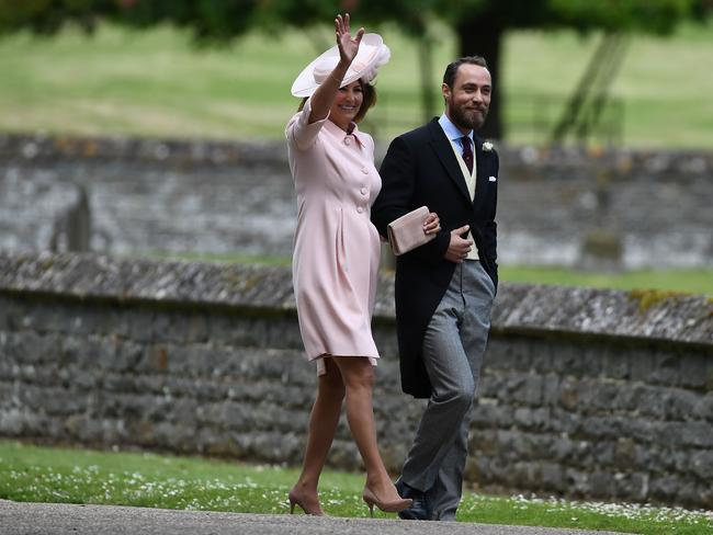 The mother and son wave to paparazzi at St Mark's Church in Englefield, west of London.