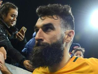 (FILES) This file photo taken on June 8, 2016 shows Australian captain Mile Jedinak leaving the field after their World Cup football Asian qualifying match against Saudi Arabia at the Adelaide Oval in Adelaide. Australia's hopes of qualifying for next year's World Cup have been dealt a blow after injury concerns forced skipper Mile Jedinak out of a 23-man squad to face Japan and Thailand in crunch qualifiers on August 23, 2017. / AFP PHOTO / BRENTON EDWARDS / --IMAGE RESTRICTED TO EDITORIAL USE - STRICTLY NO COMMERCIAL USE--