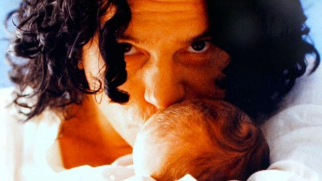 EMBARGOED ONLINE 6PM Seven's rockumentary, Michael Hutchence: The Last Rockstar features images of Hutchence with baby daughter Tigerlily. Picture: Seven