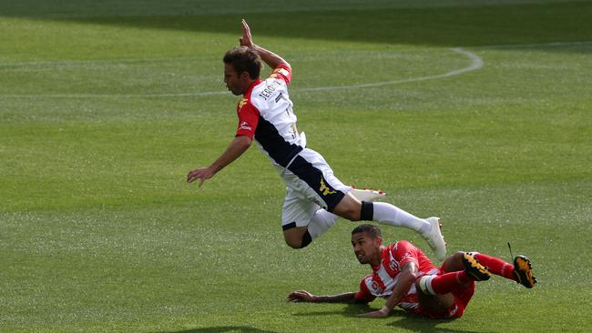 Melbourne Heart's Patrick Kisnorbo tackles Jeronimo Neumann. Pic by George Salpigtidis.