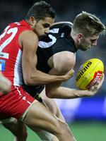 Round 20: Jackson Trengove is tackled by Swan Lewis Jetta at Adelaide Oval. Picture: Calum Robertson