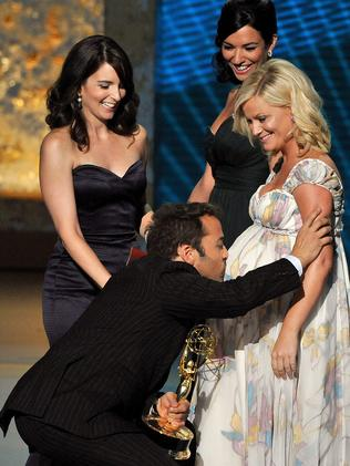Jeremy Piven kisses presenter Amy Poehler's stomach after winning an Emmy for his work on  <i>Entourage</i> in 2008.