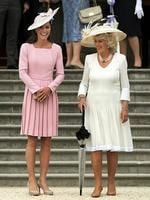 Kate and Camilla, Duchess of Cornwall attend a garden party at Buckingham Palace in May 2012 in London. Picture: Getty