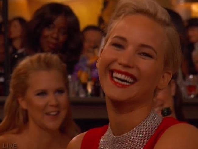 Jennifer Lawrence laughs along with the joke.