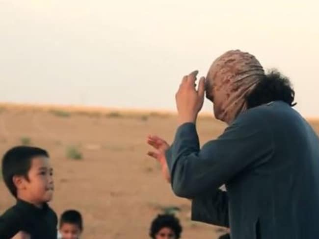A young boy can be seen taking part in a mock fight on a video at an Islamic State training camp.